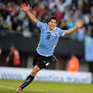 Uruguayan forward Luis Suarez celebrates at the end of the final against Paraguay (3-0) of the 2011 Copa America football tournament held at the Monumental stadium in Buenos Aires, on July 24, 2011. AFP PHOTO / ANTONIO SCORZA